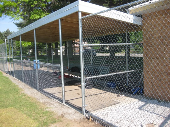 The new dugouts for both teams include a roof and new fencing. Sandscript photo by Greg Mochen.