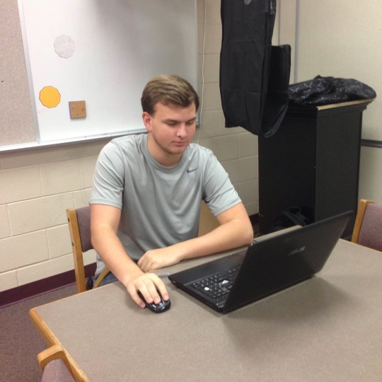 Senior Nathan Burris does research to develop a case for his final season as a Chesterton High School debater. The team's upcoming tournament at West Lafayette will be October 25. Sandscript photo by Lauren Lecy.